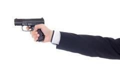 Męska ręka w garniturze z pistoletem odizolowywającym na bielu Zdjęcie Stock