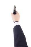 Męska ręka w kostiumu mienia pistolecie odizolowywającym na bielu Obrazy Royalty Free