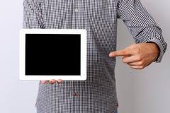 Męska ręka wskazuje na pastylka ekranie komputerowym Obraz Royalty Free