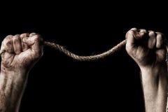 Męska ręka z arkaną Poczęcie agresja Zdjęcie Royalty Free