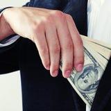 Męska ręka z dolarami Obrazy Stock