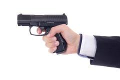 Męska ręka z pistoletem odizolowywającym na bielu Fotografia Stock