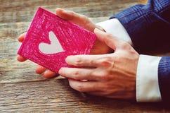 Męska ręki mienia karta obszyty dzień serc ilustraci s dwa valentine wektor Zdjęcie Stock