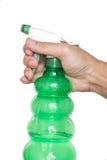 Męska ręki mienia kiści butelka Obrazy Royalty Free