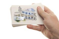 Męska ręki mienia sterta Błyskowe karty z Domowym rysunkiem Obraz Stock