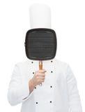 Męska szefa kuchni kucharza nakrycia twarz z grill niecką Zdjęcie Stock
