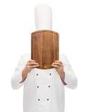 Męska szefa kuchni kucharza nakrycia twarz z tnącą deską Obrazy Stock