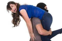 Męska złodzieja uprowadzenia przewożenia młoda dziewczyna Zdjęcie Royalty Free
