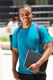 Męski afrykański student collegu outdoors Obrazy Royalty Free