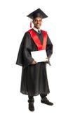 Męski amerykanina afrykańskiego pochodzenia absolwent w todze i nakrętce Zdjęcia Stock
