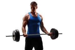 Męski bodybuilder ćwiczy z barbell Zdjęcie Stock