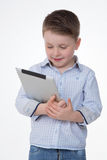 Męski dzieciaka uczenie z jego przyrządem Obrazy Royalty Free