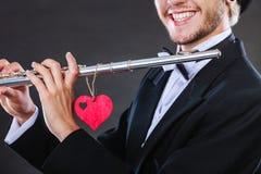 Męski flecista z fletem i sercem Miłości melodia Zdjęcia Stock