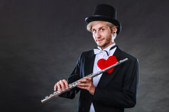 Męski flecista z fletem i sercem Miłości melodia Zdjęcie Royalty Free