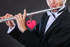 Męski flecista z fletem i sercem Miłości melodia Zdjęcie Stock
