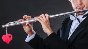 Męski flecista z fletem i sercem Miłości melodia Obraz Royalty Free