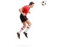 Męski gracz futbolu przewodzi piłkę Obrazy Stock