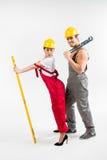 Męski i żeński budowniczych pozować Obrazy Stock