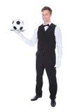 Męski kelnera przewożenia futbol Zdjęcie Royalty Free