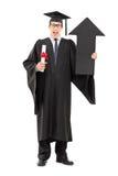 Męski magistrant/magistrantka mienie dyplom i duża strzała wskazuje up Zdjęcia Stock