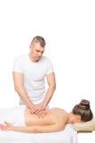 Męski masażysta robi klasycznemu masażowi dziewczyna Fotografia Royalty Free
