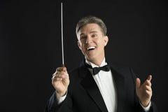 Męski orkiestra dyrygent Patrzeje Oddalony Podczas gdy Kierujący Obrazy Royalty Free