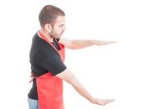 Męski pracownika mienie coś duży Zdjęcie Royalty Free