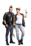 Męski punker z gitarą i żeńskim punker Fotografia Royalty Free