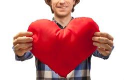 Męski ręka chwyta zabawki serce Zdjęcie Royalty Free