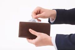Męski ręki kładzenia kondom w portfel Fotografia Royalty Free