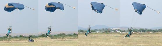 Męski skydiver przybycie wewnątrz dla szybkiego lądowania na trawie Ląduje Seria Zdjęcia Stock