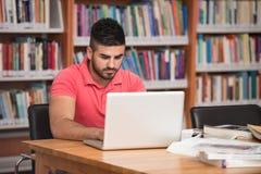 Męski student collegu Stresujący się O Jego pracie domowej Obraz Royalty Free