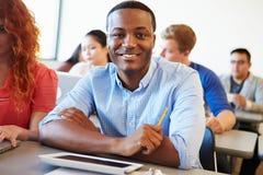Męski student uniwersytetu Używa Cyfrowej pastylkę W sala lekcyjnej Obraz Royalty Free