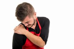 Męski supermarket pracodawcy mienia ramię jak kaleczenie zdjęcia royalty free