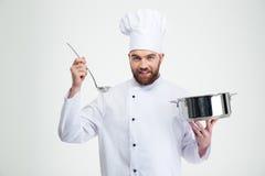 Męski szefa kuchni kucharz trzyma kopyść i rondel Obrazy Stock