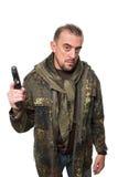 Męski terrorysta w militarnej kurtce z pistoletem wewnątrz Obrazy Stock