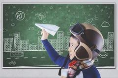 Męski uczeń bawić się papierowego samolot Fotografia Stock