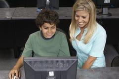 Męski uczeń I nauczyciel Używa komputer Obrazy Stock