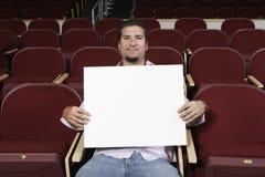 Męski uczeń Z znak deską W sala lekcyjnej Zdjęcie Royalty Free