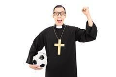 Męski wielebny mienie futbol, dźwiganie i pięść Zdjęcia Royalty Free