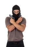 Męski złodziej jest ubranym maskę i trzyma strzela odosobnionego Obraz Stock