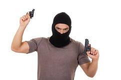 Męski złodziej jest ubranym maskę i trzyma strzela odosobnionego Obrazy Stock