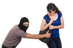 Męski złodziej obrabowywa pięknej młodej dziewczyny Obraz Stock