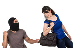 Męski złodziej obrabowywa pięknej młodej dziewczyny Zdjęcie Royalty Free