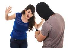 Męski złodziej z armatnim przygotowywającym obrabować młoda dziewczyna Obraz Royalty Free