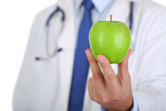 Męskie medycyny therapeutist lekarki ręki trzyma zielony świeży dojrzałego Zdjęcia Stock