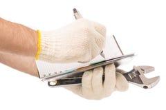 Męskie ręki w budów rękawiczek notepad piórze wytłaczają wzory budynek Zdjęcia Royalty Free
