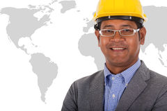 Męskiej inżynier odzieży żółty hełm z światową mapą Obrazy Stock