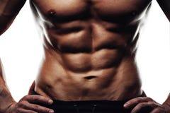 Męskiej sprawności fizycznej wzorcowy pokazuje sixpack brzuszny Zdjęcia Stock