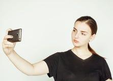Młoda ładna nastoletnia dziewczyna robi selfie odizolowywającemu up na białym tła zakończeniu Fotografia Royalty Free
